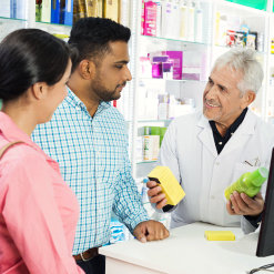 a pharmacist and his customers talking
