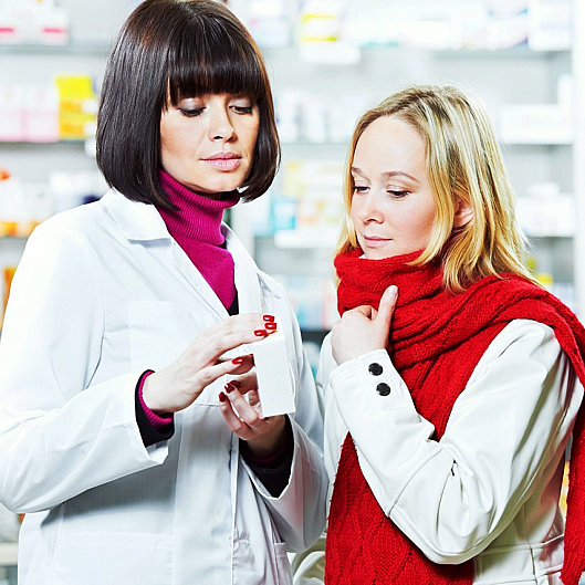 a pharmacist showing the customer her medicine
