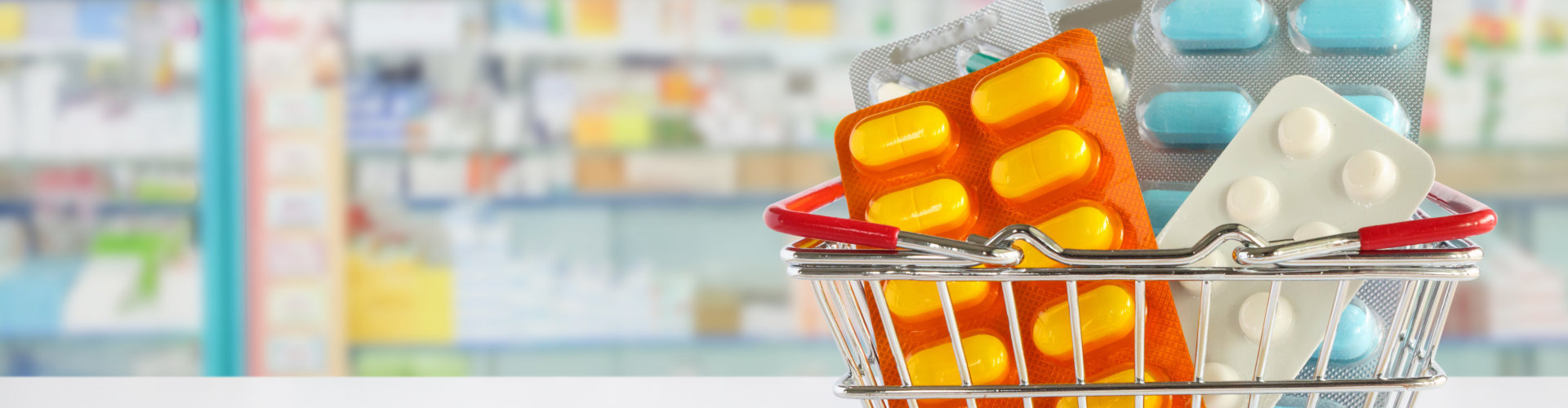 medicine pills package in shopping basket